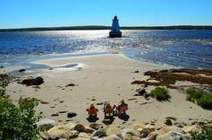 Sandy Point Lighthouse - seaside relaxing at its best!  - Ken De Roo photograph via Nova Scotia Tourism