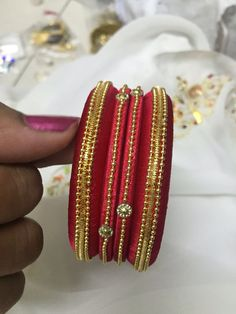 Red and gold colour combination bangles made with silk thread