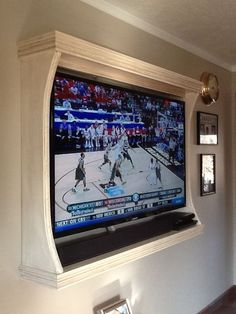 Hubby's diy Frame tv on wall