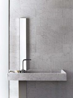 Alfredo Salvatori / Raw by Piero Lissoni luxury concrete bathroom with narrow mirror