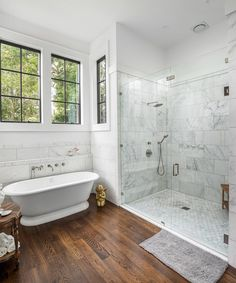 Weekender Home Tour: Riverland Terrace Retreat Marble clad master bathroom with modern tub - Marble Bathroom Dreams Modern Marble Bathroom, Small Bathroom, Master Bathroom Tub, Warm Bathroom, Minimal Bathroom, Boho Bathroom, Family Bathroom, Family Room, Bathroom Design Inspiration