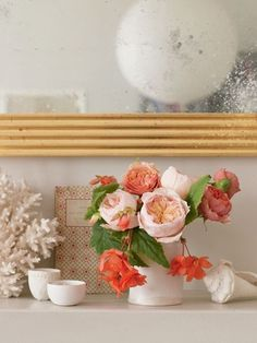 centerpiece - peach bourbon roses and coral flowers