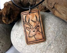 This is a handcrafted hunting jewelry deer necklace. I hand engraved the deer on this pendant using pyrography.   #deerhunting #mensfashion #woodworking #whitetaildeer #deerantler #necklace #etsy