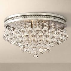 Finished in a shimmering brushed nickel, this ceiling light from Vienna Full Spectrum features iridescent crystal drops for a design that shines. Style # at Lamps Plus. Bathroom Ceiling Light, Bathroom Light Fixtures, Ceiling Light Fixtures, Bathroom Lighting, Ceiling Lights, Bedroom Ceiling, Crystal Ceiling Light, Lamp Light, Crystal Chandeliers
