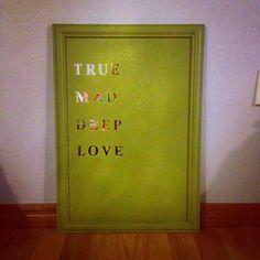 Mirror, scrapbook lettering, spray paint = wall art!