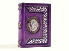 Purple Secrets journal - hand toned leather, rich embossed cover with silver finish.  Journal size is 5.25 x 4 inches (13,5 x 10 cm) and thickness is 2 inch (5 cm) without cameo. On cover exist several different work techniques what give to journal elegant and unique look. Spine of journal is decorated with genuine lizard leather in appreciate color. by aLexLibris, $85.00