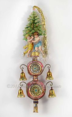 Victorian Angels Holding Tree on Double-Spire Glass Tree Topper Ornament TT15003 by DresdenStarOrnaments on Etsy https://www.etsy.com/listing/248554884/victorian-angels-holding-tree-on-double