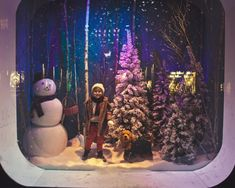 Saks 2012 Holiday Window. The dog mannequin is a nice touch to make the window display seem more realistic