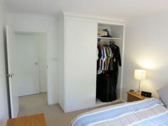 The renovated cupboards in the main bedroom of the Mount Eliza unit / apartment for sale.
