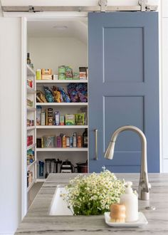 The blue barn door slides open for great access to the pantry in this kitchen. Carla Aston, Designer | Colleen Scott, Photographer Kitchen Pantry Doors, Barn Kitchen, Pantry Inspiration, Liberty House, Kitchen Remodel Before And After, Kitchen And Bath Remodeling, Blue Backsplash, Kitchen Photos, Kitchen Ideas