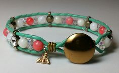 Leather wrap bracelet. Mint green with coral. Made by Dizzy Bees, find Dizzy Bees on Facebook!