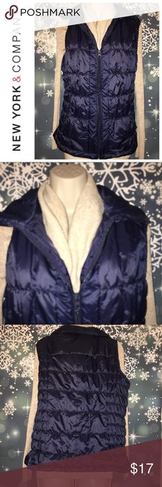 """🌇New York & Company Vest🌇 NWOT New York & Company navy blue vest with collar size XL. Puffy and warm with zip front closure. Side zipper pockets. Bust measurement pit to pit flat is 21"""". Length from the shoulder is 23"""". Shell 100% polyester with no stretch. Filling also 100% polyester. New York & Company Jackets & Coats Vests"""