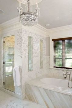 Tile and glass enclosure. A frameless glass door combined with tiled walls gives this bathroom an open look. A tile surround with frameless glass windows not only makes the shower feel bigger on the inside, it also allows plenty of light in.
