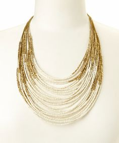 Look what I found on #zulily! Gold & White Beaded Bib Necklace by ZAD #zulilyfinds