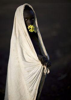 Surma boy with flowers - Turgit Ethiopia, photographer - Eric Lafforgue