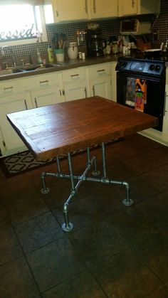 """Industrial Pedestal Pipe Leg  Dining Table 2"""" thick Rough Sawn Top by Lapalletcreations on Etsy https://www.etsy.com/listing/251529837/industrial-pedestal-pipe-leg-dining"""