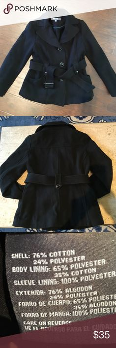 Classic Kenneth Cole Reaction belted trenchcoat Excellent condition! Classic solid black trench coat by Kenneth Cole Reaction that feels as soft & cozy like a sweatshirt. Two pockets at hip, hidden button at each cuff, large black shiny buttons that are easy to use, removable & adjustable belt. 76% cotton & 24% polyester. Kenneth Cole Reaction Jackets & Coats Trench Coats