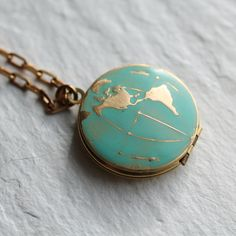 *** This world map locket is unpersonalised. Engraving or personalisation is not available on this design at the moment, but we would be happy to offer advice on the best way to add pictures yourself! *** This world map globe locket is vintage brass, which has been carefully hand