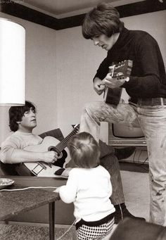 John and little Julian Lennon with George Harrison at home in 1965