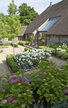 Contemporary Country Courtyard Garden Design for a barn conversion in West Susse. - Contemporary Country Courtyard Garden Design for a barn conversion in West Sussex, box, roses and hydrangeas by Sussex Garden Designers Acres Wild Source by skopecka -