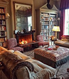 All the important elements for a warm inviting and elegant living room. Soft muted colour, books, pattern, texture, fire and lamp light. My Living Room, Interior Design Living Room, Living Room Decor, Living Spaces, Home Libraries, Cottage Interiors, Beautiful Interiors, Home Fashion, Family Room