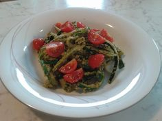 """Zucchini noodles with dried-tomato pesto. 1 serving. For the noodles cut 2-3 zucchini (not the core) with a peeler. Then put in hot boiling salted water for 5 minutes or so, you don't want the zucchini to get boiled, but to be """"al dente"""". For the pesto blend 10g of dried tomato, 45g of walnuts, 1 1/2 spoon of olive oil, 1 garlic clove, 25 g of basil, 1/2 a tea spoon of sea salt and the juice of 1/4 of lemon. Add 2 or 3 spoon of the boiling water if too dense. Finally some cherry tomatoes on…"""