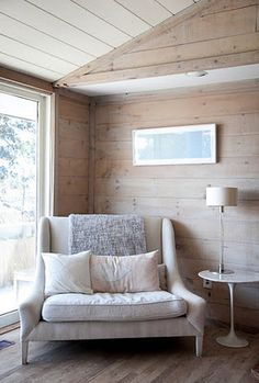 Love this light colored wood on the walls. its so inviting :)