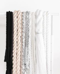 Cindy Zell | Did you know that @ikeausa sells a white adjustable-height rolling rack for $12.99?! It's perfect for holding all my hand-spun rope!