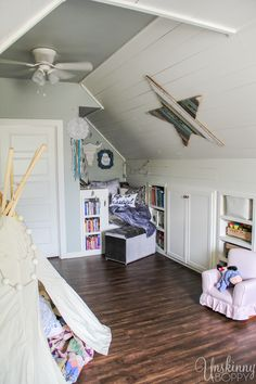 Amazing Attic Playroom - Check out this amazing Attic Renovation Before and After! They renovated the attic space above the garage into an incredible office and playroom! Love that book nook and shiplap.