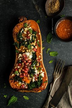 Roasted squash with kale, feta and pomegranate