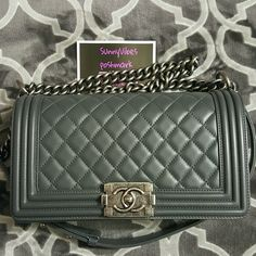 Chanel Boy Bag Old Medium size, dark grey/charcoal in lambskin leather with ruthenium hardware. Purchased from a Chanel boutique on June 2015, gently used. I have the receipt, authenticity card, tags and original box. This can be used as a crossbody or shoulder bag. The interior is clean, minor wear on edges of the bag, no scratches on the exterior. Minor scratches on the interior flap. I paid a little over $5000 for this bag, pls no lowball offers. I can email more pics, pls request them…