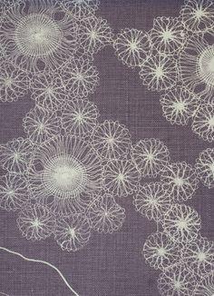 Portobello Fabric Linen Portobello Linen design inspired by lace patterns on a grey / mauve background.