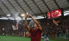 Totti captures the moment in the Stadio Olimpico. Photograph: Alessandro Bianchi/Reuters.