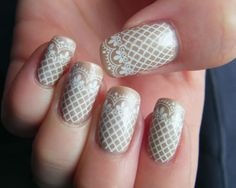fun...this is the design I have on my nails right now...mine is silver w/blue lace though
