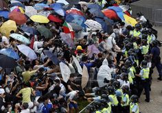 HONG KONG'S UMBRELLA REVOLUTION 9/2014   Umbrellas are used by the protesters as a means of protecting themselves against tear gas and pepper spray.