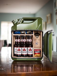 is the Beer Bar. Holds more than enough beers for you and your friends. Comes with built in bottle opener, built in bottle cap magnet and loads of space to keep some snacks. Heading out and about but want to bring some beer? We got you covered! Man Cave Diy, Man Cave Home Bar, Man Cave Fridges, Jerry Can Mini Bar, Classy Man Cave, Bottle Cap Magnets, Bottle Opener, Beer Caddy, Man Cave Basement