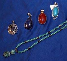 Gemstone Jewelry - Pendants and Jade chain    Unique pieces made from different healing stones.