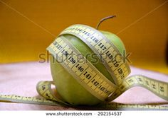 apple and centimeter - stock photo