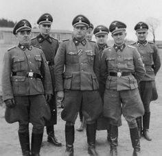 """A group of concentration camp """"administrators"""" pose for the photographer. Very """"professional"""" in every way, they presided over the life and death of all who had the terrible misfortune to be placed in their """"care."""" Even more horribly, most of them escaped punishment after the war."""