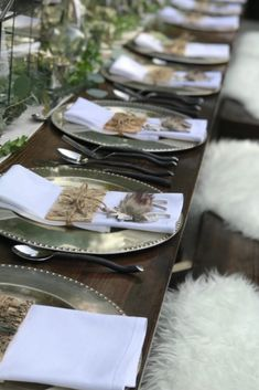 TABLE DECOR | NgLp Designs shares minimalist and elegant Nordic table decor in a White Winter Wonderland theme — neutral decor with lots of white and green, bark, and sheepskin fur | table, table setting, table decor, tableware, Scandinavian style /// #minimalist #tabledecor #scandinavian Setting Table, Table Settings, Viking Party, Norway Viking, Fur Decor, Nordic Vikings, Winter Wonderland Theme, Viking Wedding, Scandinavian Style