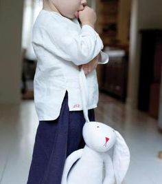 This enchanting soft toy rabbit has been hand made from the finest linen handed down through several generations.