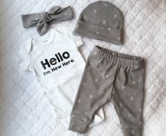 Looking for a perfect outfit to bring your baby home in?! This one is perfect for you! The set includes leggings, onesie, and hat or headband. You can also select items individually in the drop down menu. I use Carters bodysuits and heat transfer vinyl. The vinyl is applied using a heat press for optimal adhesion. The leggings, headband and hat are made of comfortable knit. The saying on the onesie can be changed (Hello World, Hello Im New Here, ect...), just send me a message to discuss…