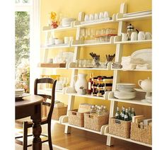 I love ladder shelves.  I want these for my kitchen but they are so expensive!!