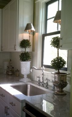 love white kitchens & this faucet