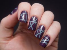 Would love to try this with 'Pat on the Black' as the base colour!   Purple and blue laser tape manicure! | Chalkboard Nails | Nail Art Blog