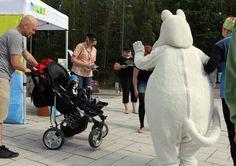 Moomin troll meets a young fan. The Day of Finnish Nature 2015. Photo: Metsähallitus / Antti Saario