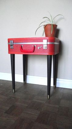 Upcycled table using vintage luggage with legs attached.