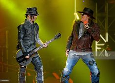 Guitarist Dj Ashba (L) and singer Axl Rose of Guns N' Roses perform at The Joint inside the Hard Rock Hotel & Casino during the opening night of the band's second residency, 'Guns N' Roses - An Evening of Destruction. No Trickery!' on May 21, 2014 in Las Vegas, Nevada.