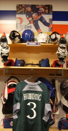 Travis Hamonic's locker room stall with the St. Patrick's Day inspired green warmup jersey.