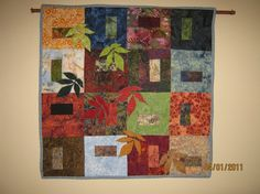 Quilted batik wall hanging/table cover  by QuiltingMissDaisy